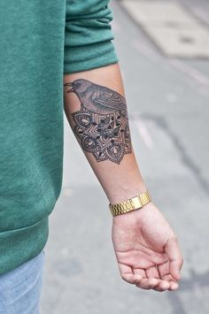 An Example of a Bird and Mandala Forearm Tattoo Idea For Men - See more at: http://tattooideasmag.com/#sthash.jUxChFmz.dpuf