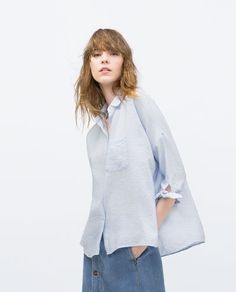 Image 1 of OVERSIZED BLOUSE WITH COMBINED COLLAR from Zara