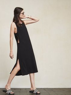 The Adobe Dress lets you show skin, but in a kinda sneaky way. It might look basic from the front but it's got tricks. https://www.thereformation.com/products/adobe-dress-solitaire?utm_source=pinterest&utm_medium=organic&utm_campaign=PinterestOwnedPins