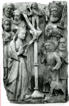 Alabaster panel; polychrome; carved; St Catherine of Alexandria refusing to sacrifice to the idol; St Catherine stands on left; behind are three male figures, on other side of tall pedestal surmounted by idol stand the emperor Maxentius with a sword; from her hand issues a scroll; on right of panel stands a man leading an animal, and another man holding a book; foreground coloured green with red and white flowers; background originally gilded with raised spots. 15c England.