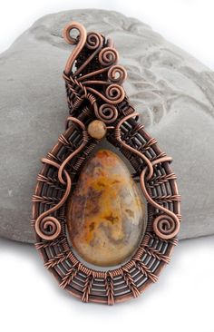 Birds on Sunrise This Crazy Lace Agate has gorgeous markings, really peacefull. It is complemented with an elegant wrap with copper wire. The pendant comes with a handmade infinity chain. This is a real one of a kind eye-catcher.  Are you looking for a piece of jewelry for yourself or someone you care about? This jewelry is handmade and therefore each piece is unique. Do you want something special as an expression of yourself, to reflect your inner beauty, your unique personality and style?…