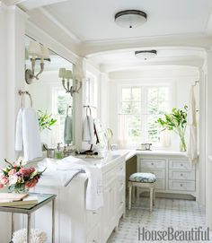 I love everything about this bathroom, especially the windows and all of the lightness/white. I do not like the huge towels and towel rings by the sinks, too cluttered.
