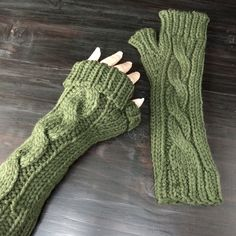 Olive Army Green cabled fingerless texting gloves Thicker fingerless arm warmers/gloves/mitts ideal for texting and Poshing. They cover all but my middle fingers; so I like them rolled down. The color is a beautiful deep dark olive army green, same yarn I used for the crochet hat in my closet. These photos were taken in studio lighting. The hat was shot during the late afternoon in natural filtered light. Will measure them when I get back.  Fingerless gloves are essential to smartphone…