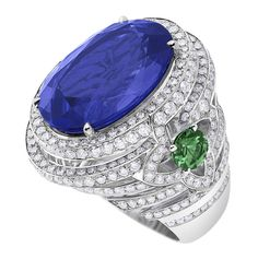 Orangerie des Tuileries ring from the Escale á Paris collection of jewels by Louis Vuitton featuring a large central Tanzanites, green tsavorites and diamonds.