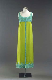 Image: Column-like evening dress with scoop neckline and narrow shoulder straps, made of bright acid green synthetic silk. The dress has a h...