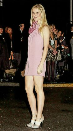 Gwyneth Paltrow leggy in a short pink dress