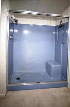 Your selling your house and this is your bathroom. Solution: call Miracle Method. Shower stall in perfect shape. Every Realtor will tell you; the first rooms prospective buyers check out - the kitchen and the bathroom. One look at this tubstall could stop the buyer in their tracks. Miracle Method's professional refinishing will transform this blue to a neutral white in 24 hours. The warranty is transferrable. Bonus: a fraction of the cost of replacement.