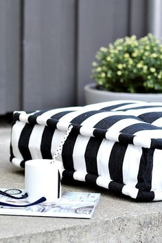 Outdoor relaxation area captures spring sunshine striped floor pillow #monochrome