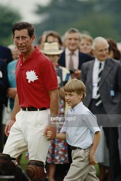 Charles holding the hand of his son