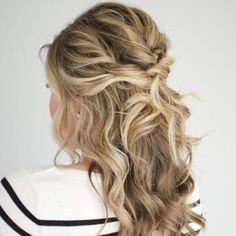 Another variation of a half-up, half-down prom hairstyle, this twisted half-updo by The Small Things Blog is perfect for when you want to party with your friends without worrying about your hair getting in your face.