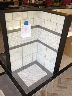 From the Arizona Tile showroom - Mixing different scale tiles, framing in gray with a touch of classic Hexagon tile makes this shower surround POP!