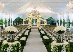 An abundance of white flowers for an elegant garden wedding under a tent ~ Wildflower Linen