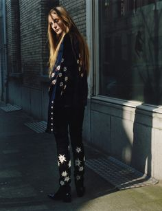 The romantic spirit of early Joni Mitchell — peasant dresses, poet blouses and textured coats — is toughened up when paired with a simple Chelsea boot.