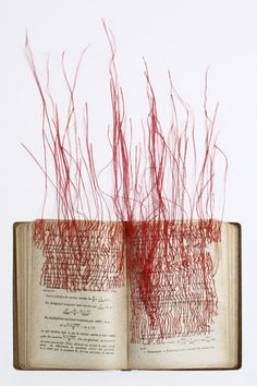 Adore the simplicity of red thread in altered book   Art by Mireille Vautier