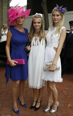 Cara, pictured when she was 15 with her mother Pandora and middle sister Poppy, at the wedding of her eldest sister Chloe in 2007