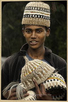 young man selling traditional hats in the hills above Addis Ababa, Ethiopia