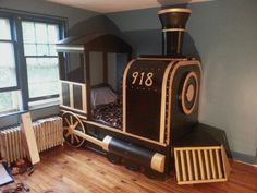 """What an incredible parent! """"Train Bed I made for my son. I had a tight budget so I used a lot of scrap materials including old closet doors, bucket and garbage can lids, and a lampshade. Train Bedroom, Old Closet Doors, Woodworking Projects That Sell, Kids Woodworking, Scrap Material, Cool Beds, Awesome Beds, Kid Beds, Boy Room"""