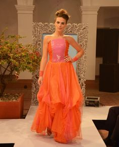 Dusk orange and sunset-pink embroidered satin-and-net gown with a bubble-skirt (INR 10,990)