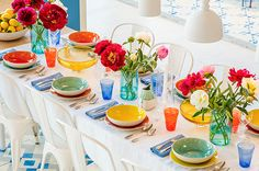 Bright flowers and a bowl full of lemons bring this table to life!