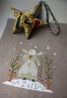 Star is an EEF pattern Cross Stitch House, Just Cross Stitch, Cross Stitch Finishing, Cross Stitching, Cross Stitch Embroidery, Cross Stitch Patterns, Cross Stitch Christmas Ornaments, Christmas Cross, Sewing Stitches