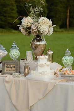 Vintage Gatsby-inspired outdoor dessert and candy bar display #wedding #gatsby #vintage #dessert #candybar