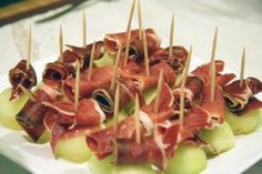 Jamón Serrano Wrapped Melon. This makes a great sweet and savory appetizer for summer gatherings!  It's also very quick and very easy. http://black-java.com/spanish-food-recipes/jamon-serrano-wrapped-melon