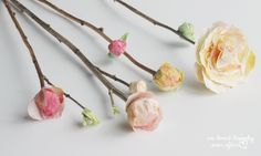 How to make realistic flower buds. Many other flower tutorials.. awesome site, this blogger has some serious creative talents http://www.welivedhappilyeverafter.com/2014/04/how-to-make-flower-buds-attatch-paper.html