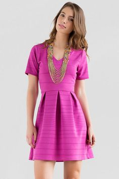 """We love the pink berry hue of this textured dress! The Vineyard Crochet Dress features a horizontal striped texture finished with a crochet cutout in the back. Style with a statement necklace & wedges for a finished look.<br />  <br />  - 34"""" length from shoulder to hem<br />  - 32"""" chest<br />  - 26"""" waist<br />  - 65"""" sweep<br />  - measured from a size small<br />  <br />  - 100% Polyester<br />  - Hand Wash<br />  - Imported"""