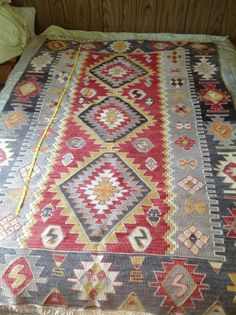 "I really really like this one!  Lots of color but would go with the tans and grays in room.  On Ebay Vintage  Native American Indian Hand Woven Wool Rug Blanket Navajo? 48 x 72"" Old"