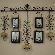 wrought iron wall hanging- so Santa barbara tuscan.. just my style!