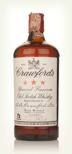 Crawford's 3 Star Blended Scotch Whisky - 1970s This bottle of Crawford's 3 Star Blended Whisky was made in the 1970s for the international market. The bottle itself is a rather interesting shape, being quite stout and square, but it's still a handsome fellow for sure.