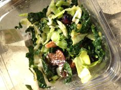Kale and cabbage salad with fresh figs, blueberries, celery, walnuts, orange citrus vinaigrette