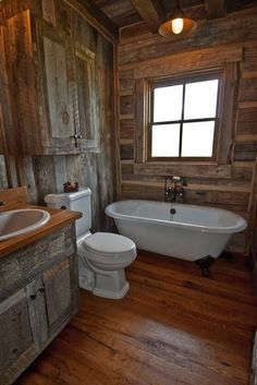 Love this rustic cabin bathroom!