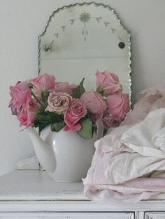 Oh, I love this mirror, the tea pot the roses, the pile of linens, the dresser and that's all.