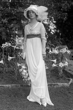 """Photo of """"Russian ballerina Anna Pavlova, who became the first ballet dancer to tour the world with her own dance company. She moved to London in 1912 and is photographed here in her Hampstead garden wearing a soft belted gown, hat and her ballet shoes."""" Featured in """"British Vogue"""" in an article about the time of the Titanic."""