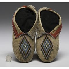 Kickapoo Beaded Hide Moccasins thread-sewn, soft-soled moccasins with beadwork in translucent pink, amber, green, cobalt, and pony trader blue; cuffs edged in red and faded blue cotton, length 9.5 in. late 19th century Price Realized Including Buyer's Premium $570 08/11/2016