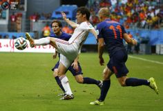 World Cup Final 2010 Rematch Spain vs Netherlands in Pictures - Spain's Silva fights for the ball with Robben and Blind of the Netherlands during their 2014 World Cup Group B soccer match at the Fonte Nova arena in Salvador . MICHAEL DALDER/REUTERS