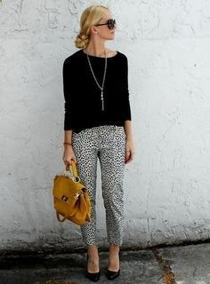 printed pants black shirt and bright bag chic business casual outfit