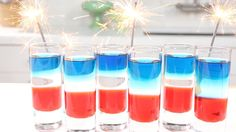 It's official -- These are the most patriotic shots ever! Layer grenadine, peach schnapps, and blue curacao for an easy, colorblocked drink.