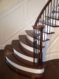 Staircases & Bannister Millwork [GALLERY] Gorgeous wrought iron balluster stairs with painted treads and risers Wrought Iron Stair Railing, Stair Railing Design, Home Stairs Design, Staircase Railings, Curved Staircase, Interior Stairs, Banisters, Railing Ideas, Staircases
