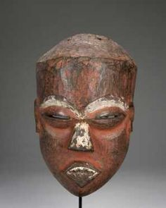 """A fine Eastern Pende mask - Eastern Pende DR Congo H: 9"""" A fine old Eastern Pende face mask, with wide high brow, deep ocular orbits with raised coffee-bean eyes, wedge shaped nose and toothy mouth. The whole with remains of red pigment. A very fine and classical example."""