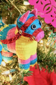 Celebrate Navidad with a festive tree that is full of rich colors and decor! http://www.lauraslittleparty.com/2016/12/feliz-navidad-fiesta-themed-christmas.html