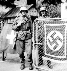 A Swiss soldier and a German soldier posing near the Jura border, 1940 .The only country neighboring Germany that Hitler never occupied was Switzerland Germany Ww2, Man Of War, The Third Reich, German Army, Swiss Army, Luftwaffe, Military History, Armed Forces, World War Ii