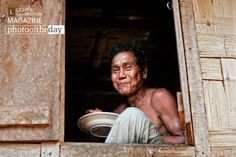Meaning of Happiness, by Rezwan Razzaq - Happiness often sneaks in through the window you didn't know you left open. This shot was taken at a Bandarbans, Bangladesh. The man in this shot is an aboriginal. I had taken this shot on his house yard at noon when he was having his lunch.