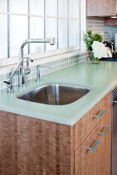 Love this recycled glass countertop. The color is gorgeous and it's easy to keep clean and doesn't stain.
