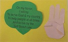 Girl Scout Promise project - customize as necessary.  Have different colored skintone construction paper and girls can match their own or use a different color to trace their hand for the GS sign.