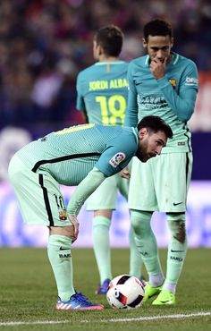Barcelona's Argentinian forward Lionel Messi bends beside Barcelona's Brazilian forward Neymar during the Spanish Copa del Rey (King's Cup) semi final first leg football match Club Atletico de Madrid vs FC Barcelona at the Vicente Calderon stadium in Madrid on February 1, 2017. / AFP / JAVIER SORIANO