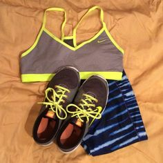 Nike Sports Bra Nike gray and yellow sports bra. Worn only once, excellent condition. Smoke free home. Nike Tops
