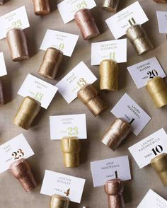 A Metallic New Year's Eve Wedding in Philly | Martha Stewart Weddings - To hold the escort cards in New Year's Eve style, Champagne corks (ordered online in bulk) were hand-painted and scored by Carrie, McCormick, and other friends and family members—one of several projects that occupied the weeks leading up to the wedding.