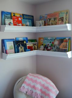 Corner Bookshelves in the nursery - these were made from rain gutters! #DIY